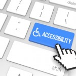Keyboard with blue button reading 'accessibility' with wheelchair symbol
