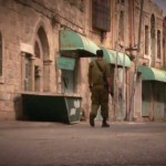 soldier walking in occupied territory
