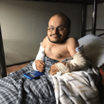 Qusai recovering in bed. Photo credit: Darrin Zammit Lupi/JRS Europe)