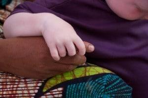 Albino child hand holding on mum's hand