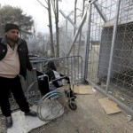 Girl in wheelchair sits silently at shut Macedonian border for hours
