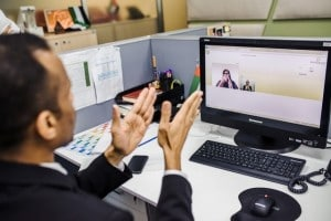 Man signing in front of computer