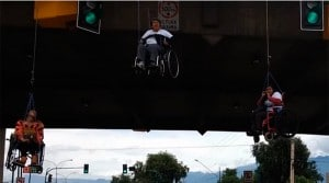 disabled protesters in bolivia hanging off bridge in whellchairs in protest
