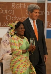 Vicky Ntetema with John Kerry